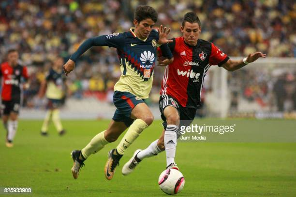 Carlos Orrantia of America fights for the ball with Cristian Calderon of Atlas during the 2nd round match between America and Atlas as part of the...
