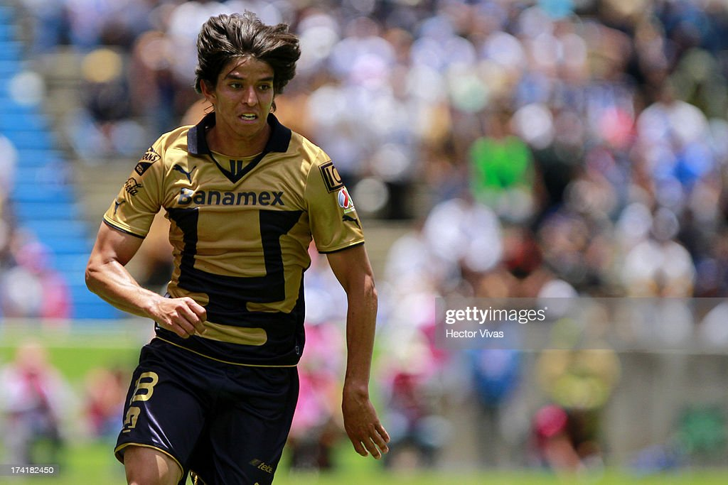 Carlos Orrantia of Pumas in action during a match between Pumas and Puebla as part of the Torneo Apertura 2013 Liga Mx at Cuauhtemoc Stadium on July 21, 2013 in Puebla, Mexico.