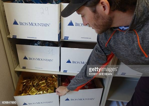 Carlos Padron a researcher at the University of Miami opens a drawer full of condoms on November 30 that will be handed out at a new syringe exchange...