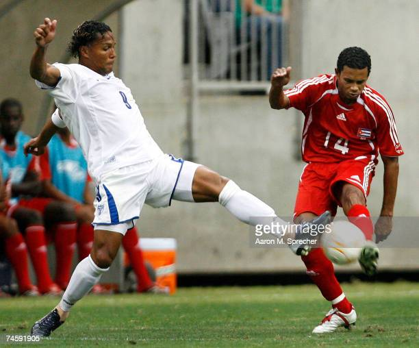 Carlos Pavon of Honduras goes for the ball against Jaime Colome of Cuba during their first round match of the CONCACAF Gold Cup 2007 tournament on...