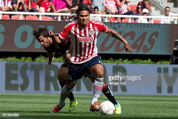 Carlos Peña of Chivas fights for the ball with Alvaro Gonzalez of Atlas during the 14th round match between Chivas and Atlas as part of the Clausura...