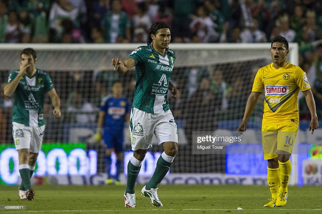 Carlos Pe–ña of Leon celebrates after scoring during the leg 1 of a Championship match between Leon and America as part of the Playoffs Apertura 2013 Liga MX at Leon Stadium on December 12, 2013 in Leon, Mexico.
