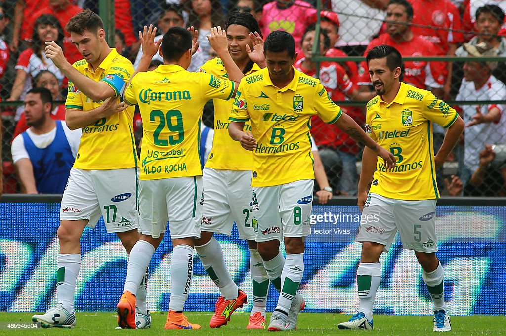 Carlos Peña of Leon celebrates with his teammates after scoring the second goal of his team during a 7th round match between Toluca and Leon as part...