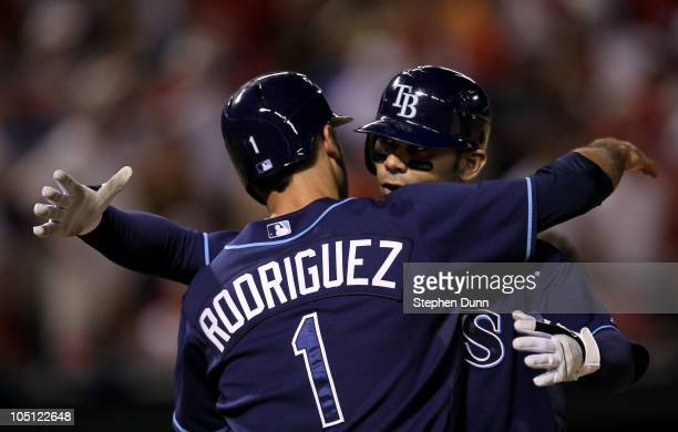 Carlos Pena and Sean Rodriguez of the Tampa Bay Rays hug at home plate after they score on Pena's two run home run in the ninth inning against the...