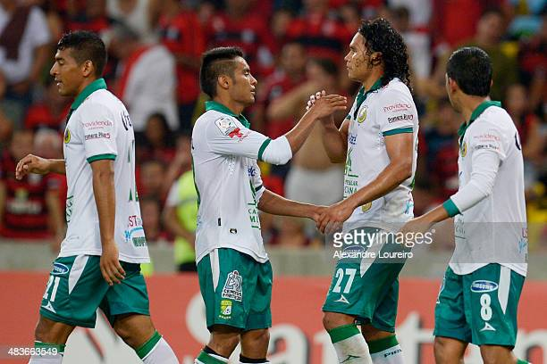 Carlos Pena celebrates with his teammates a scored goal the third of his team during a match between Flamengo and Leon as part of Copa Bridgestone...