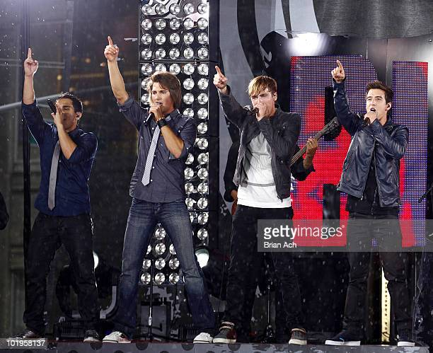 Carlos Pena James Maslow Kendall Schmidt and Logan Henderson of musical group Big Time Rush perform in Times Square on June 10 2010 in New York City