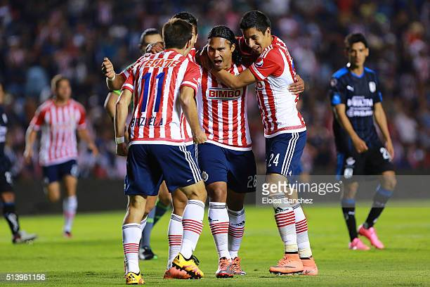 Carlos Pen–a of Chivas celebrates with his teammates after scoring the second goal of his team during the 9th round match between Queretaro and...