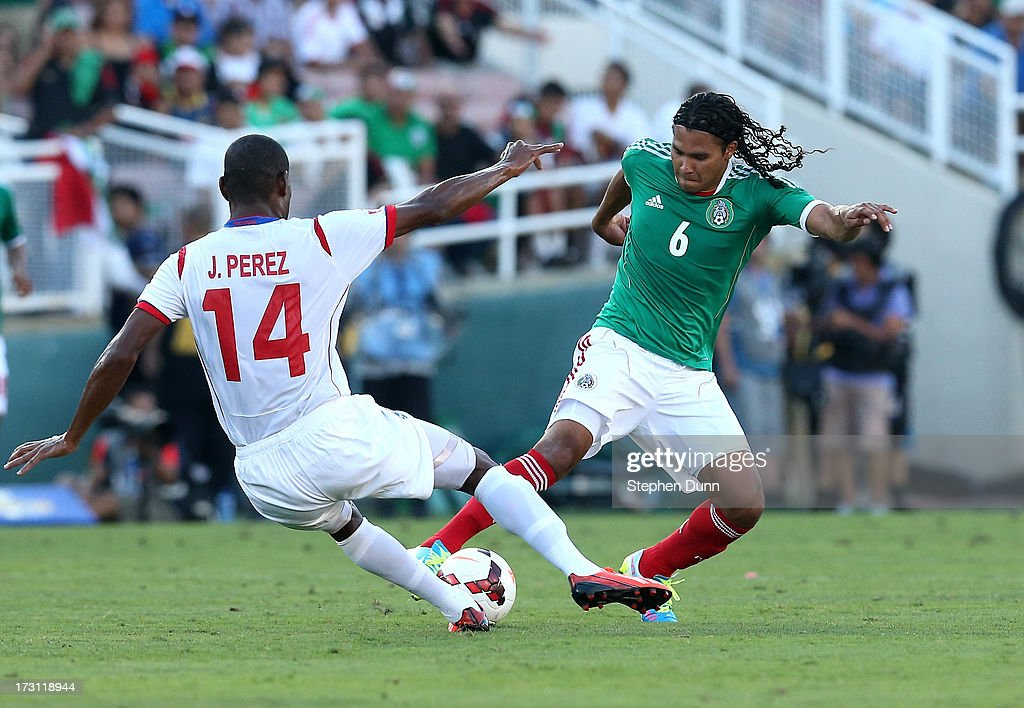 Carlos Pena #6 of Mexico controls the ball against Juan Perez #14 of Panama during the first round of the 2013 CONCACAF Gold Cup at the Rose Bowl on July 7, 2013 in Pasadena, California. Panama won 2-1.