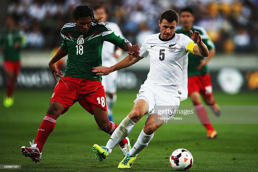 Carlos Pena of Mexico defends against Tommy Smith of New Zealand during leg 2 of the FIFA World Cup Qualifier match between the New Zealand All Whites and Mexico at Westpac Stadium on November 20, 2013 in Wellington, New Zealand.