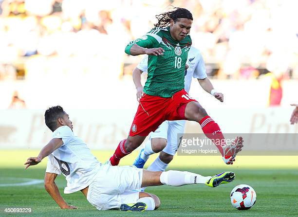 Carlos Pena of Mexico evades the tackle of Bill Tuiloma of New Zealand during leg 2 of the FIFA World Cup Qualifier match between the New Zealand All...