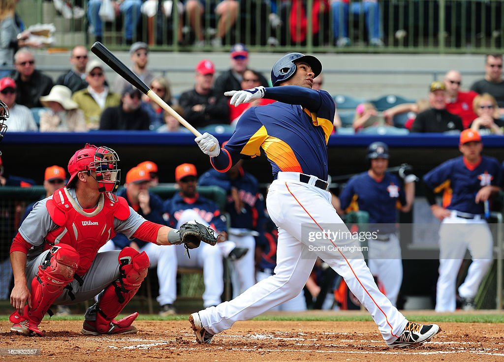 Carlos Pena #12 of the Houston Astros hits against the St. Louis Cardinals during a spring training game at Osceola County Stadium on March 1, 2013 in Kissimmee, Florida.