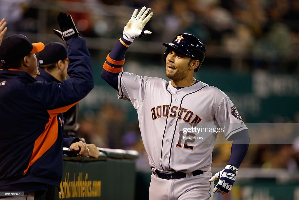 Carlos Pena #12 of the Houston Astros is congratulated by teammates after he hit a solo home run to tie their game against the Oakland Athletics in the eighth inning at O.co Coliseum on April 16, 2013 in Oakland, California.