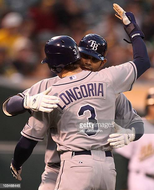 Carlos Pena of the Tampa Bay Rays celebrates with Evan Longoria after hitting a two run home run against the Oakland Athletics in the fourth inning...