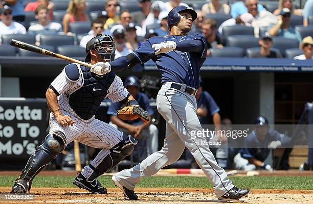 Carlos Pena of the Tampa Bay Rays follows through on a first inning three run home run against the New York Yankees on July 18 2010 at Yankee Stadium...
