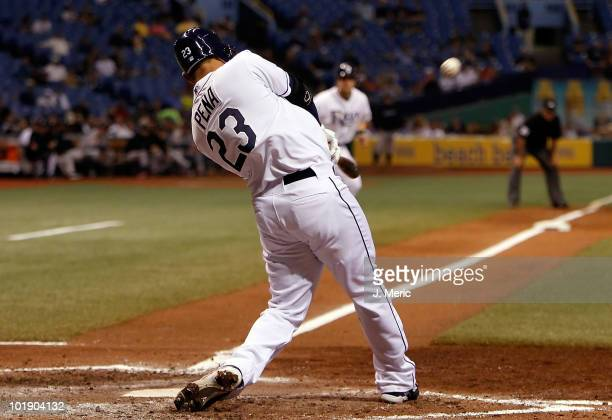 Carlos Pena of the Tampa Bay Rays hits a grand slam in the fifth inning against the Toronto Blue Jays during the game at Tropicana Field on June 8...