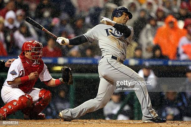 Carlos Pena of the Tampa Bay Rays hits a RBI single in the top of the sixth inning against the Philadelphia Phillies during game five of the 2008 MLB...