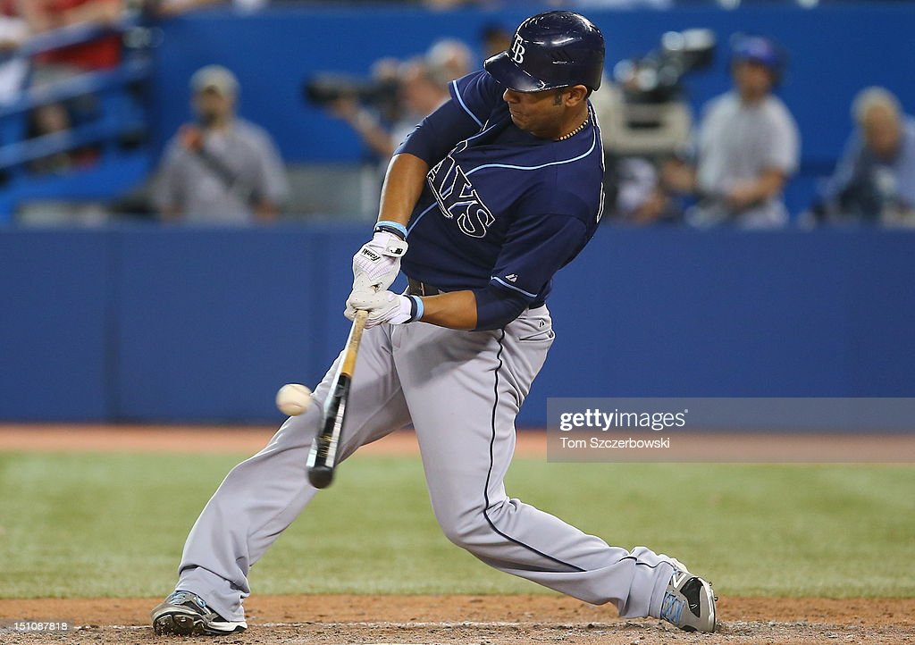 Carlos Pena #23 of the Tampa Bay Rays hits a single in the ninth inning during MLB game action against the Toronto Blue Jays on August 31, 2012 at Rogers Centre in Toronto, Ontario, Canada.