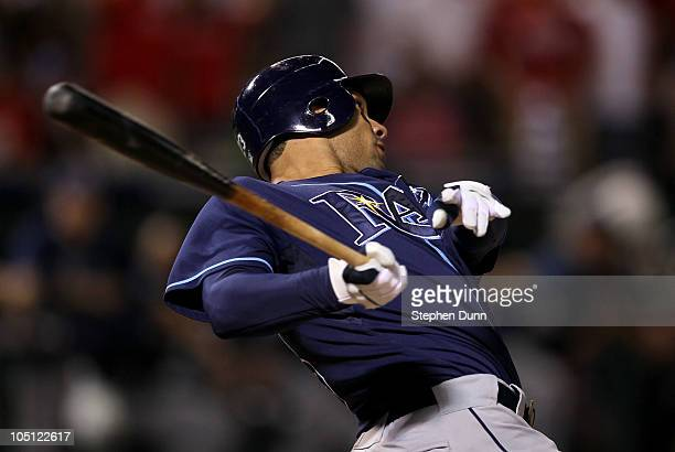 Carlos Pena of the Tampa Bay Rays hits a two run home run in the ninth inning against the Texas Rangers during game three of the ALDS at Rangers...