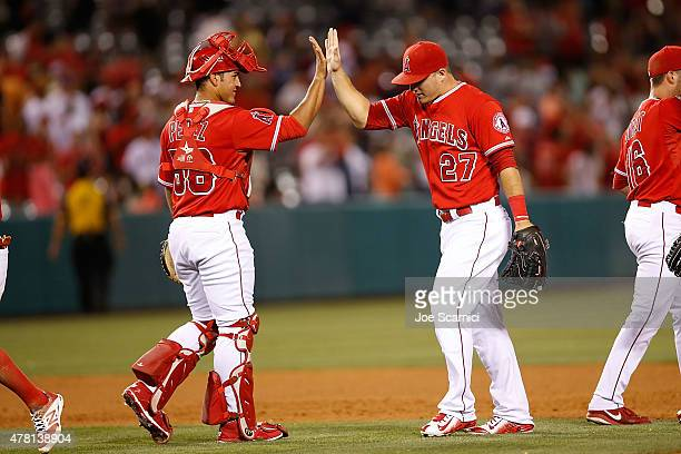 Carlos Perez of the Los Angeles Angels and Mike Trout of the Los Angeles Angels celebrate their 43 win over the Houston Astros at Angel Stadium of...