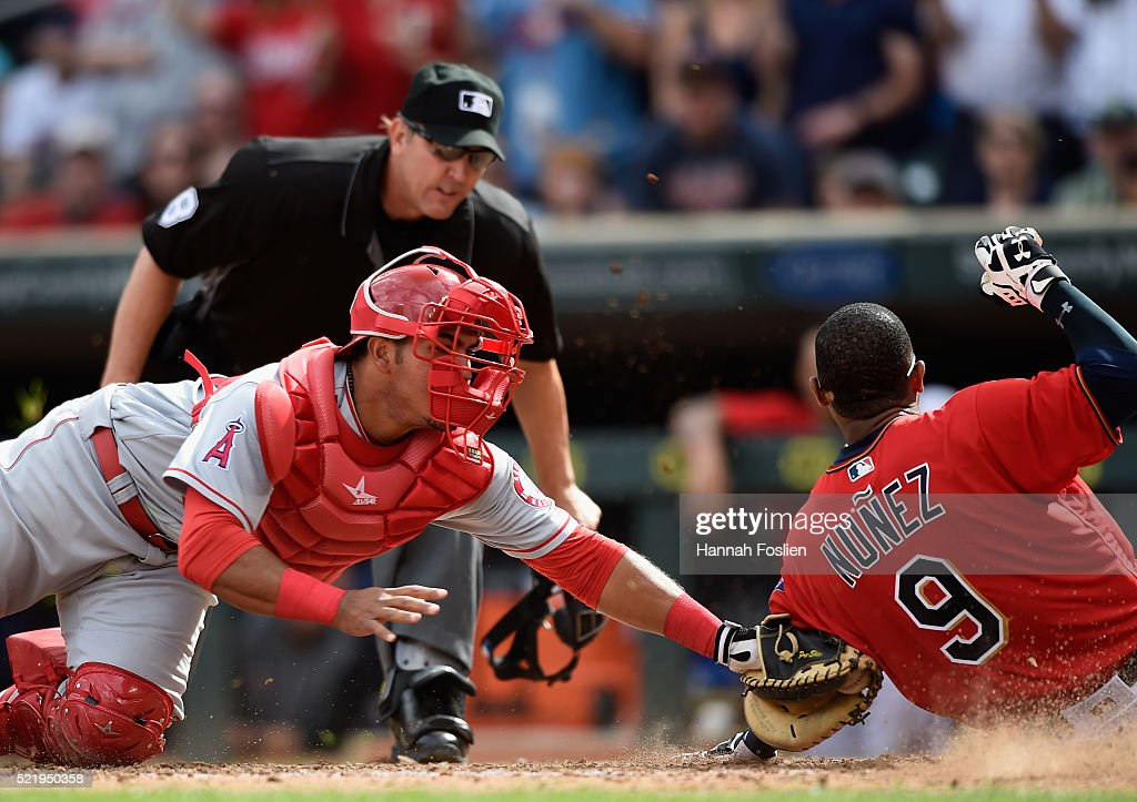 Carlos Perez #58 of the Los Angeles Angels of Anaheim defends home plate against <a gi-track='captionPersonalityLinkClicked' href=/galleries/search?phrase=Eduardo+Nunez&family=editorial&specificpeople=4900197 ng-click='$event.stopPropagation()'>Eduardo Nunez</a> #9 of the Minnesota Twins during the seventh inning of the game on April 17, 2016 at Target Field in Minneapolis, Minnesota. The Twins defeated the Angels 3-2 in twelve innings.