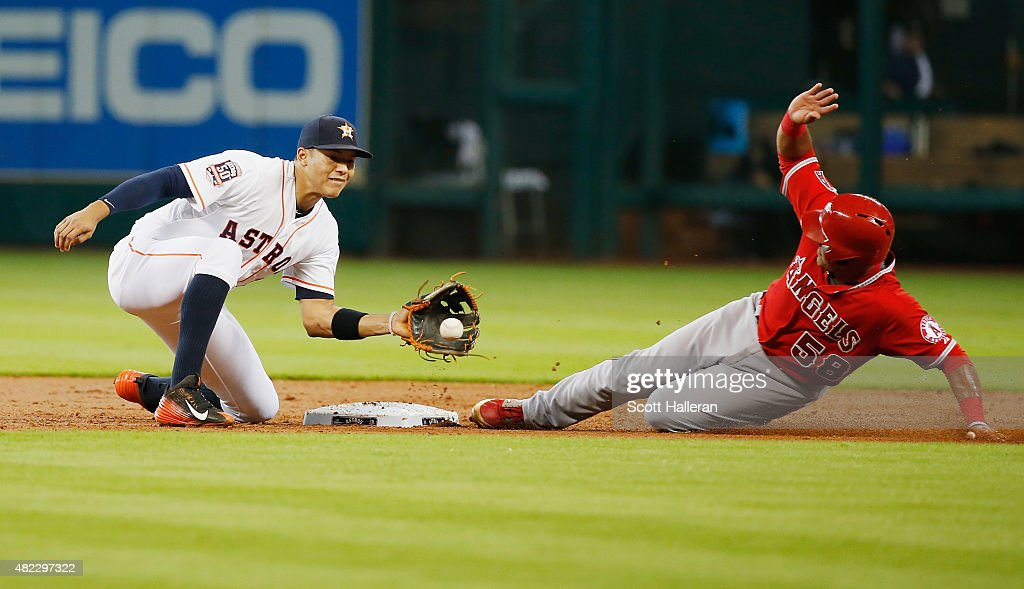 Carlos Perez of the Los Angeles Angels of Anaheim steals second base under the tag of Carlos Correa of the Houston Astros in the third inning during...