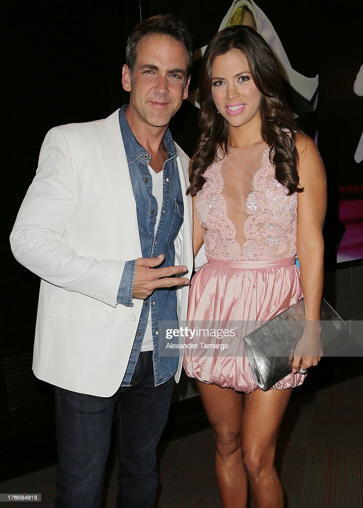 <a gi-track='captionPersonalityLinkClicked' href=/galleries/search?phrase=Carlos+Ponce&family=editorial&specificpeople=215458 ng-click='$event.stopPropagation()'>Carlos Ponce</a> and <a gi-track='captionPersonalityLinkClicked' href=/galleries/search?phrase=Ximena+Duque&family=editorial&specificpeople=4463075 ng-click='$event.stopPropagation()'>Ximena Duque</a> pose backstage at Telemundo's Premios Tu Mundo Awards at American Airlines Arena on August 15, 2013 in Miami, Florida.