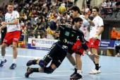 Carlos Prieto of RheinNeckar Loewen is challenged by Nenad Vuckovic of Melsungen during the Toyota Handball Bundesliga match between RheinNeckar...