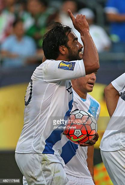 Carlos Puiz of Guatemala celebrates his second half goal against Trinidad and Tobago during a match in the 2015 CONCACAF Gold Cup at Soldier Field on...