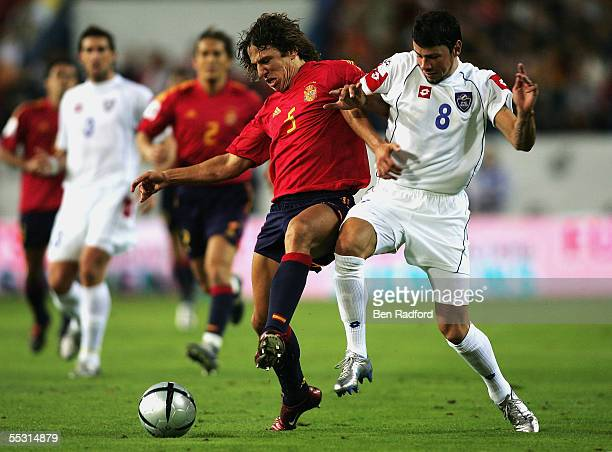 Carlos Puyol of Spain battles with Matia Kezman of Serbia during the 2006 World Cup qualifying match between Spain and Serbia Montenegro at the...