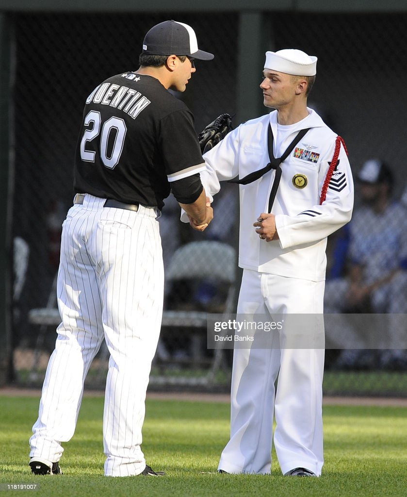 <a gi-track='captionPersonalityLinkClicked' href=/galleries/search?phrase=Carlos+Quentin&family=editorial&specificpeople=836474 ng-click='$event.stopPropagation()'>Carlos Quentin</a> # 20 and the Chicago White Sox honor the military before a game against the Kansas City Royals on July 4, 2011 at U.S. Cellular Field in Chicago, Illinois.