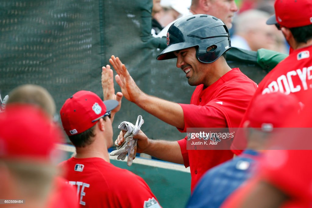 Carlos Quentin #18 of the Boston Red Sox celebrates after scoring on a RBI single against the Philadelphia Phillies in the second inning during a spring training game at Spectrum Field on March 12, 2017 in Clearwater, Florida.