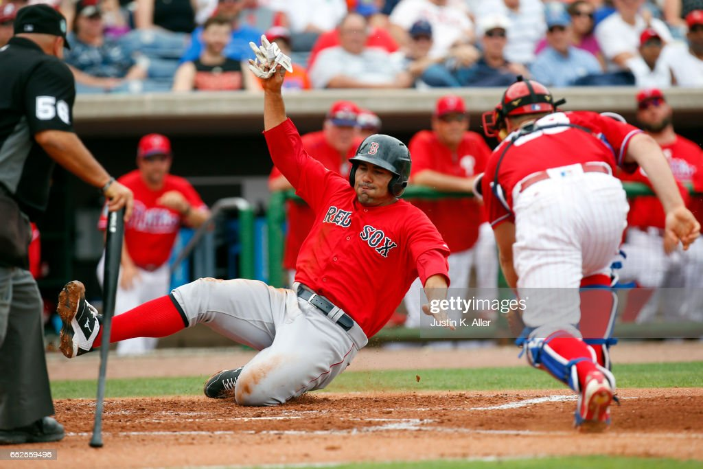 Carlos Quentin #18 of the Boston Red Sox scores on a RBI single against Bryan Holaday #59 of the Philadelphia Phillies in the second inning during a spring training game at Spectrum Field on March 12, 2017 in Clearwater, Florida.
