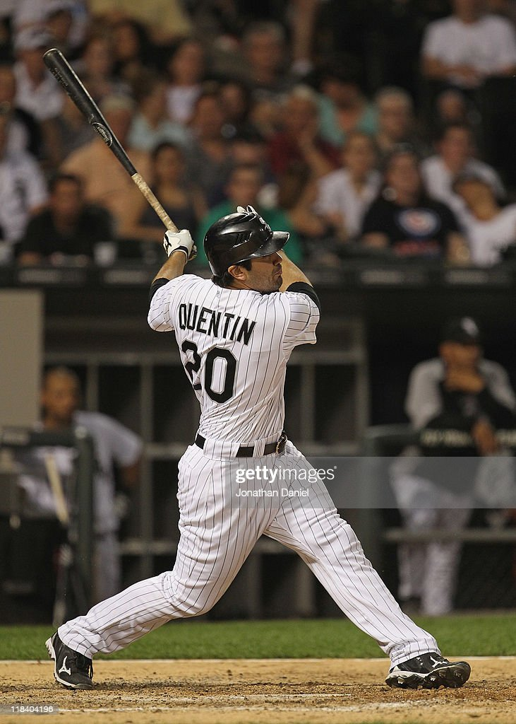 <a gi-track='captionPersonalityLinkClicked' href=/galleries/search?phrase=Carlos+Quentin&family=editorial&specificpeople=836474 ng-click='$event.stopPropagation()'>Carlos Quentin</a> #20 of the Chicago White Sox hits the ball against the Seattle Mariners at U.S. Cellular Field on June 8, 2011 in Chicago, Illinois. The Mariners defeated the White Sox 7-4 in 10 innings.