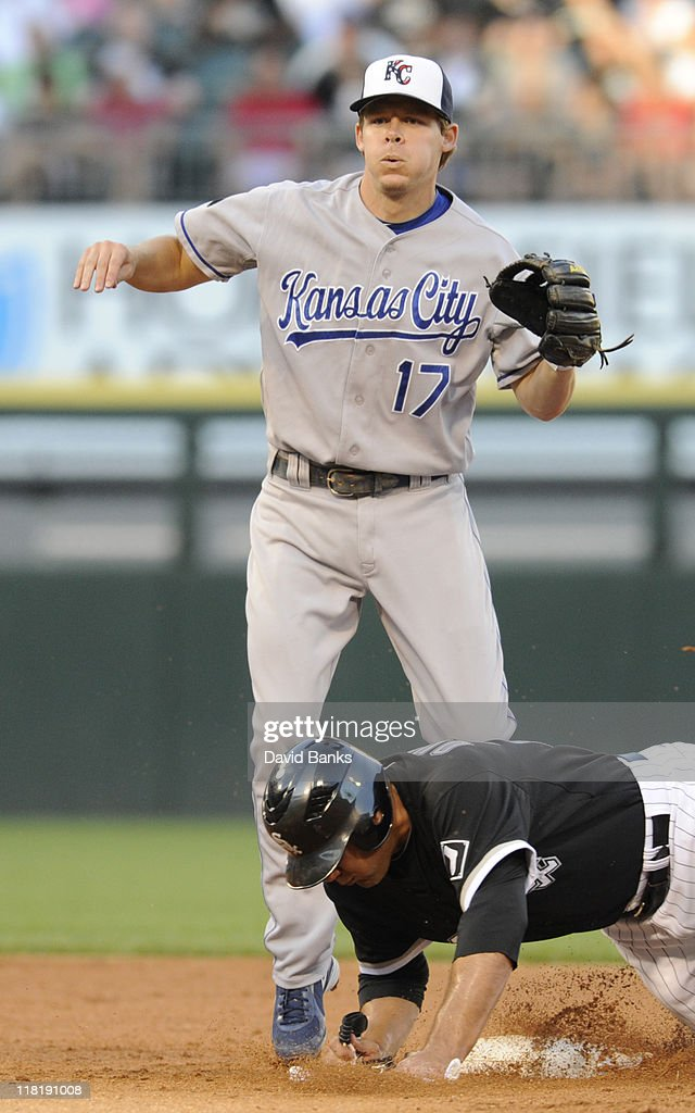 <a gi-track='captionPersonalityLinkClicked' href=/galleries/search?phrase=Carlos+Quentin&family=editorial&specificpeople=836474 ng-click='$event.stopPropagation()'>Carlos Quentin</a> #20 of the Chicago White Sox is forced out by <a gi-track='captionPersonalityLinkClicked' href=/galleries/search?phrase=Chris+Getz&family=editorial&specificpeople=4936717 ng-click='$event.stopPropagation()'>Chris Getz</a> #17 of the Kansas City Royals on July 4, 2011 at U.S. Cellular Field in Chicago, Illinois.