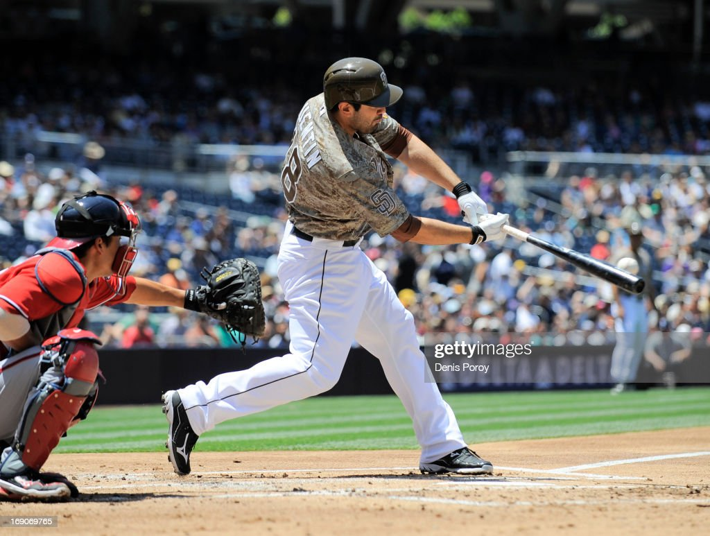 Carlos Quentin #18 of the San Diego Padres hits a double during the first inning of a baseball game against the Washington Nationals at Petco Park on May 19, 2013 in San Diego, California.