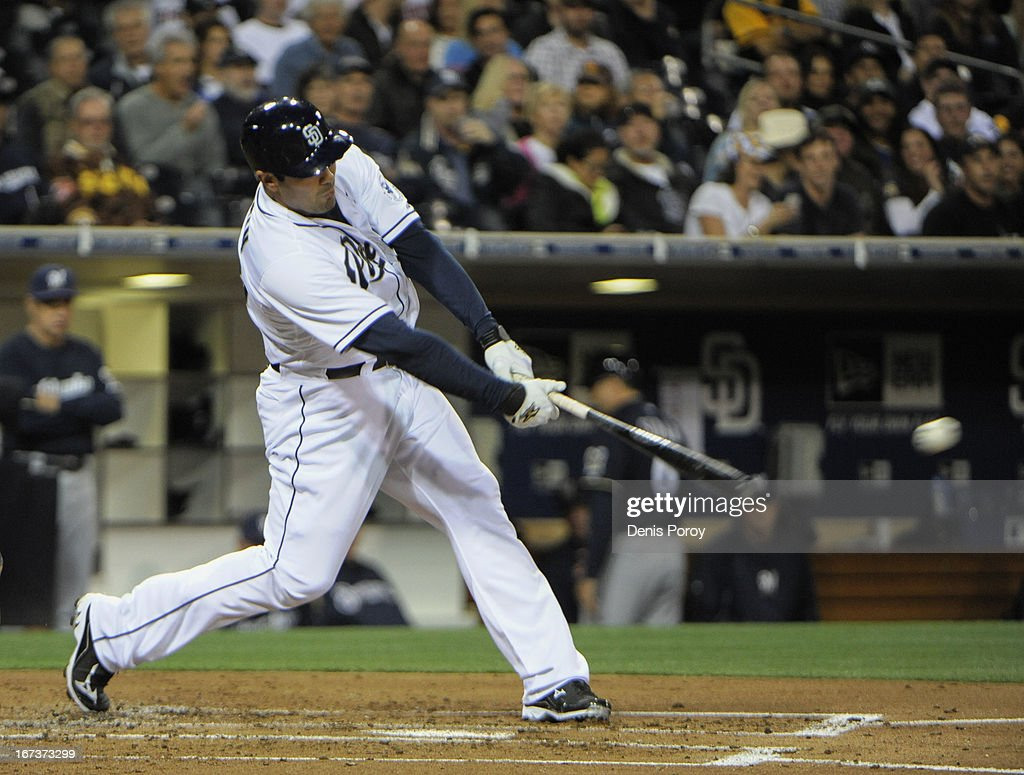 Carlos Quentin #18 of the San Diego Padres hits a single during the second inning of a baseball game against the Milwaukee Brewers at Petco Park on April 24, 2013 in San Diego, California.