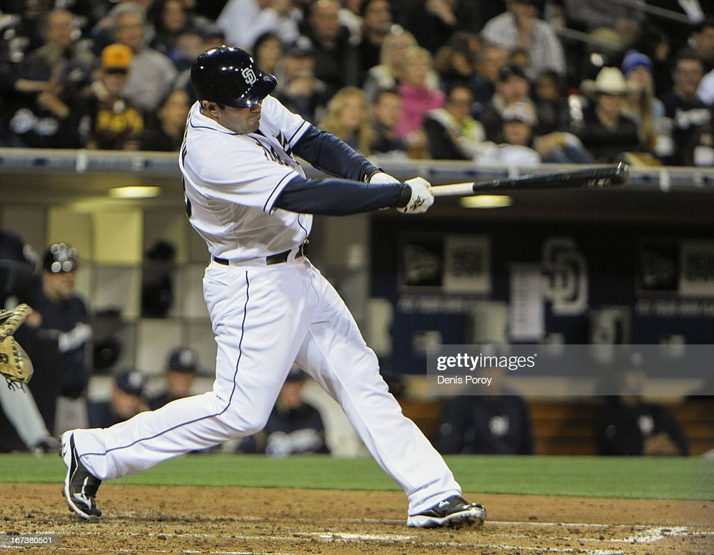Carlos Quentin #18 of the San Diego Padres hits a solo home run during the fourth inning of a baseball game against the Milwaukee Brewers at Petco Park on April 24, 2013 in San Diego, California.