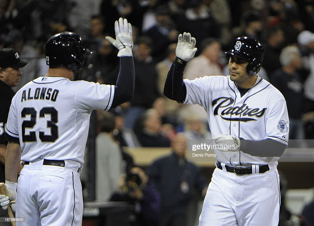 Carlos Quentin #18 of the San Diego Padres, right, is congratulated by Yonder Alonso #23 after hitting a solo home run during the fourth inning of a baseball game against the Milwaukee Brewers at Petco Park on April 24, 2013 in San Diego, California.