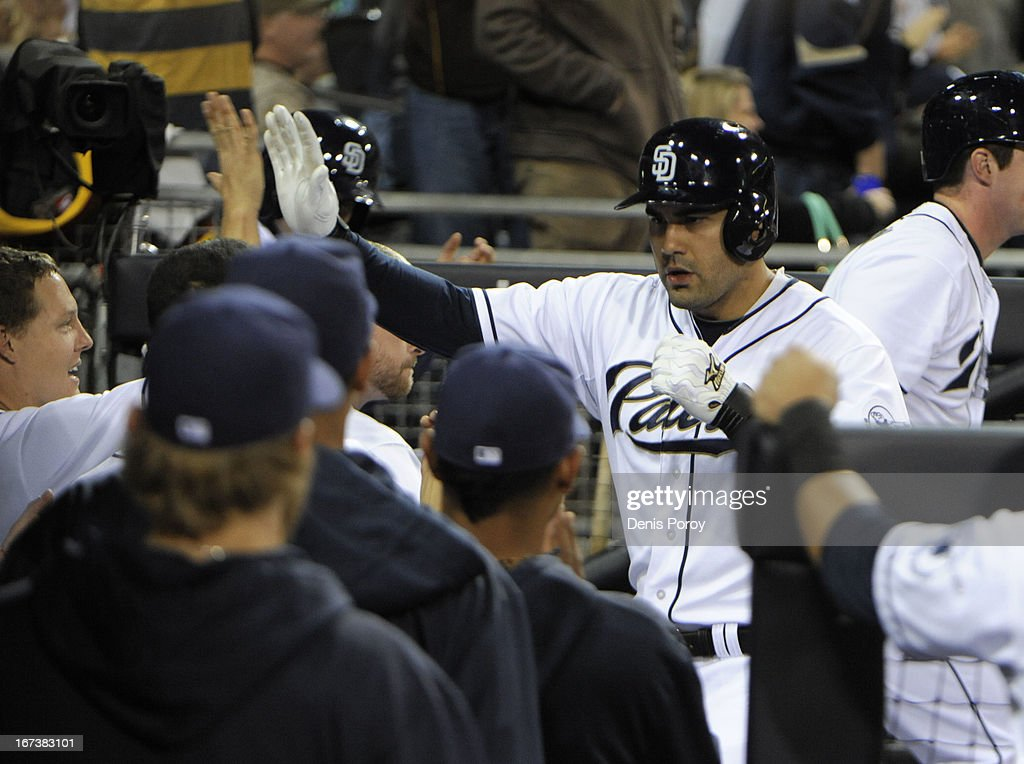 Carlos Quentin #18 of the San Diego Padres, right, is congratulated Nick Hundley #4 of the San Diego Padres after hitting a solo home run during the fourth inning of a baseball game against the Milwaukee Brewers at Petco Park on April 24, 2013 in San Diego, California.