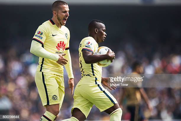 Carlos Quintero of America celebrates with Dario Benedetto after scoring during the semifinals second leg match between Pumas UNAM and America as...