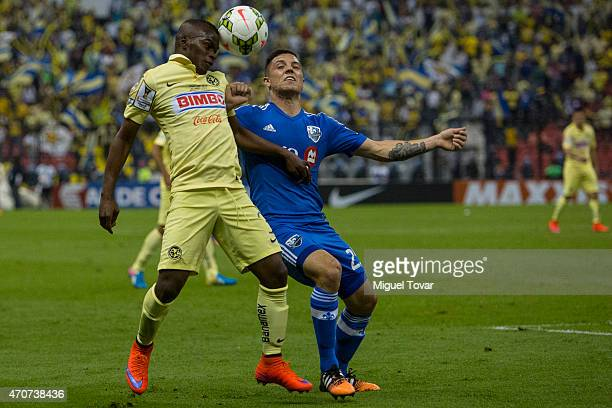 Carlos Quintero of America fights for the ball with Donny Toia of Impact during a Championship first leg match between America and Montreal Impact as...