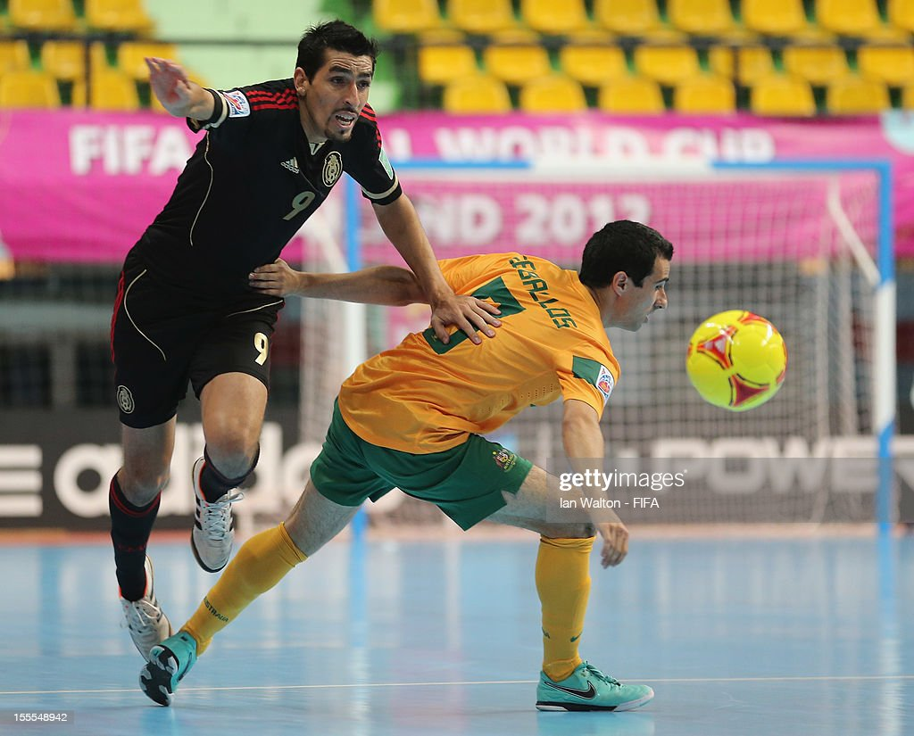 Carlos Ramirez of Mexico and Chris Zeballos (R) of Australia compete for the ball during the FIFA Futsal World Cup Thailand 2012, Group D match between Australia and Mexico at Nimibutr Stadium on November 5, 2012 in Bangkok, Thailand.