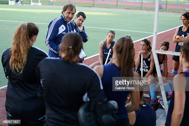 Carlos Retegui coach of Las Leonas and Los Leones gives instructions to his players during a training session as part of Argentina Female Hockey Team...