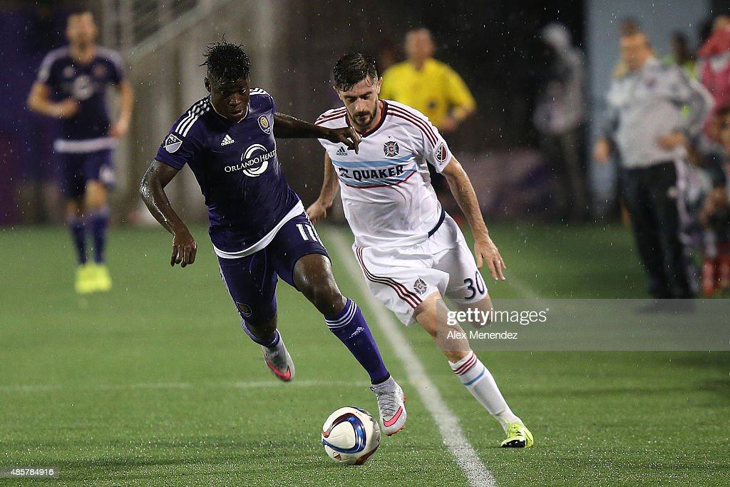 Carlos Rivas #11 of Orlando City SC and Razvan Cocis #30 of Chicago Fire chase a loose ball during an MLS soccer match between the Chicago Fire and the Orlando City SC at the Orlando Citrus Bowl on August 29, 2015 in Orlando, Florida. The game ended in a 1-1 draw.