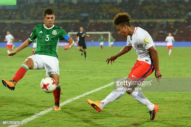 Carlos Robles of Mexico and Pedro Guerrero of Chile in action during the FIFA U17 World Cup India 2017 group E match between Mexico and Chile at...