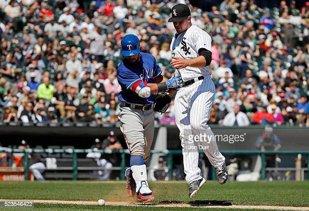 Carlos Rodon of the Chicago White Sox collides with Rougned Odor of the Texas Rangers as they both watch his hit roll foul during the fifth inning at...