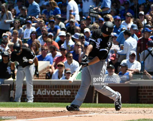 Carlos Rodon of the Chicago White Sox hits a double against the Chicago Cubs on July 25 2017 at Wrigley Field in Chicago Illinois The Cubs defeated...