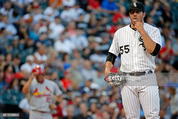 Carlos Rodon of the Chicago White Sox on the pitcher's mound between pitches to Yadier Molina of the St Louis Cardinals at US Cellular Field on July...