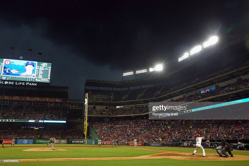 <a gi-track='captionPersonalityLinkClicked' href=/galleries/search?phrase=Carlos+Rodon&family=editorial&specificpeople=10954086 ng-click='$event.stopPropagation()'>Carlos Rodon</a> #55 of the Chicago White Sox throws a pitch to <a gi-track='captionPersonalityLinkClicked' href=/galleries/search?phrase=Drew+Stubbs+-+Baseball+Player&family=editorial&specificpeople=4498334 ng-click='$event.stopPropagation()'>Drew Stubbs</a> #15 of the Texas Rangers under dark clouds in the second inning at Globe Life Park in Arlington on May 10, 2016 in Arlington, Texas.