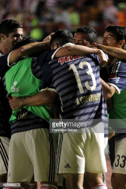 Carlos Rodríguez of Chivas celebrates a scored goal with teammates during a match between Atlante and Chivas as part of the Clausura 2014 Liga MX at...